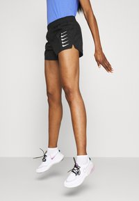 Nike Performance - RUN SHORT - Pantalón corto de deporte - black/white - 3