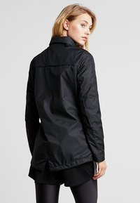 Nike Performance - ACADEMY - Hardshell jacket - black/white - 3