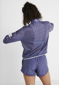 Nike Performance - AIR - Hardloopjack - sanded purple/white - 2