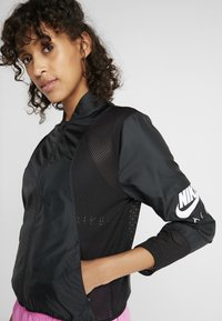 Nike Performance - AIR - Sports jacket - black/white