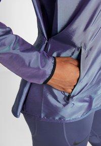 Nike Performance - AIR - Běžecká bunda - voltage purple/light aqua/electric green/black - 7