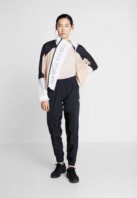 Nike Performance - AIR - Sports jacket - shimmer/black/white - 1