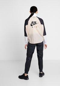 Nike Performance - AIR - Sports jacket - shimmer/black/white - 2