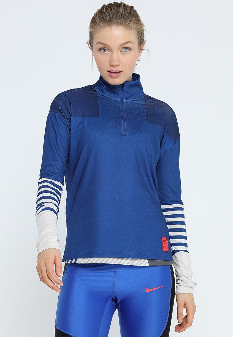 Nike Performance - Funktionsshirt - indigo force/desert sand
