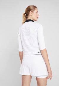 Nike Performance - Zip-up hoodie - white/black - 2