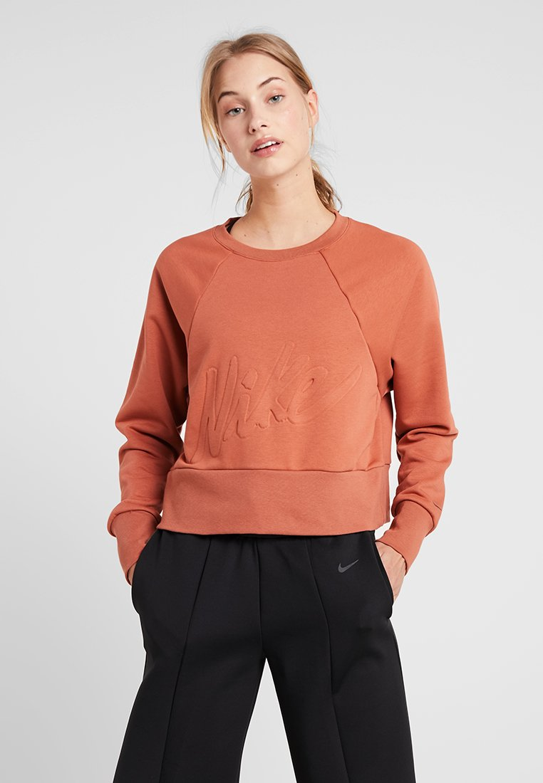 Nike Performance - DRY GET FIT LUX - Sweatshirt - dusty peach