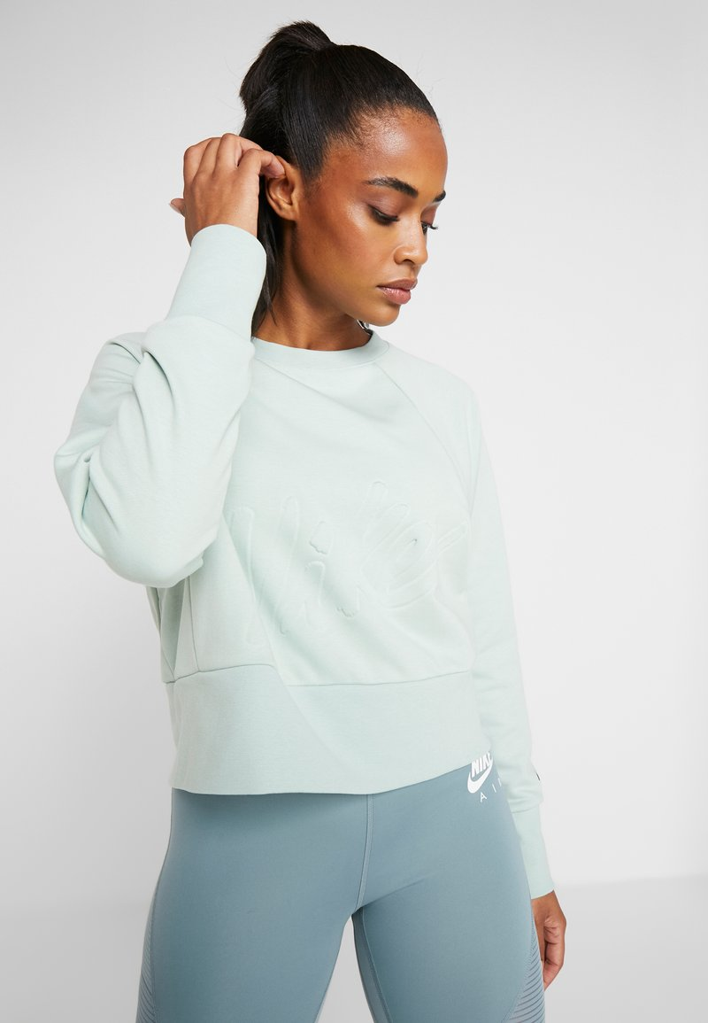 Nike Performance - DRY GET FIT LUX - Sweatshirt - pistachio frost