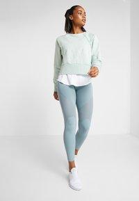 Nike Performance - DRY GET FIT LUX - Sweatshirt - pistachio frost - 1