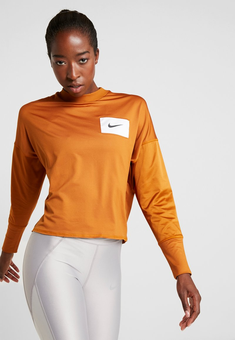 Nike Performance - MIDLAYER CREW REBEL - Sports shirt - burnt sienna/white/black