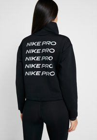 Nike Performance - CROPPED MOCK NECK - Sweater - black/metallic silver - 2