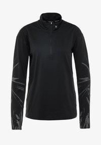 Nike Performance - T-shirt sportiva - black/reflective silver - 4