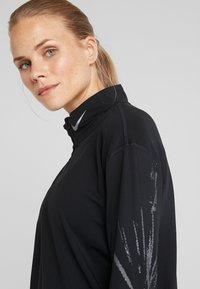 Nike Performance - T-shirt sportiva - black/reflective silver - 3