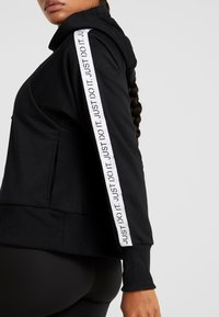 Nike Performance - NK DRY FLC GET  - Zip-up hoodie - black/white