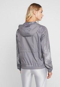 Nike Performance - Sports jacket - gunsmoke/white - 2