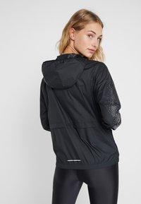 Nike Performance - Sports jacket - black/vivid purple - 2