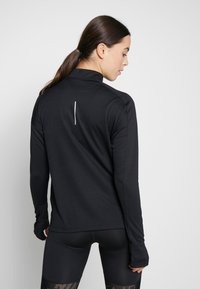 Nike Performance - PACER  - Sportshirt - black/reflective silver - 2
