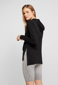 Nike Performance - YOGA COVERUP - Camiseta de manga larga - black - 2