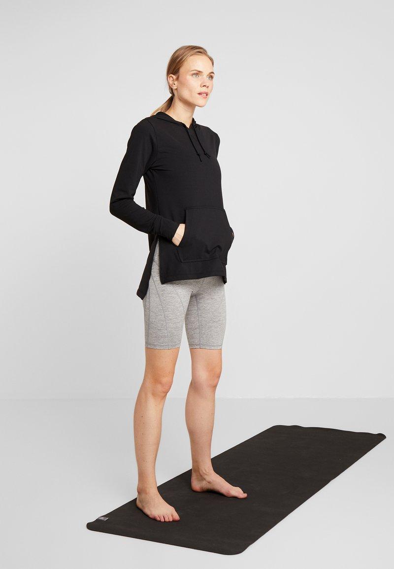 kritiskt grupp Stol  Nike Performance YOGA COVERUP - Långärmad tröja - black - Zalando.se