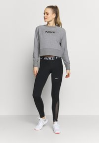 Nike Performance - DRY GET FIT - Sweatshirt - carbon heather/black - 1
