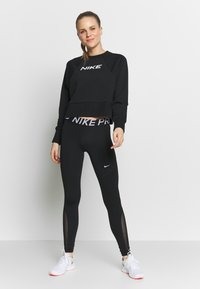 Nike Performance - DRY GET FIT - Sweatshirt - black/white - 1