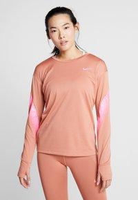 Nike Performance - MIDLAYER RUNWAY - Sports shirt - terra blush/digital pink - 0
