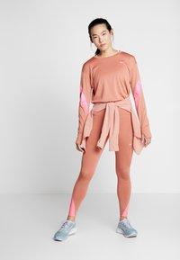 Nike Performance - MIDLAYER RUNWAY - Sports shirt - terra blush/digital pink - 1