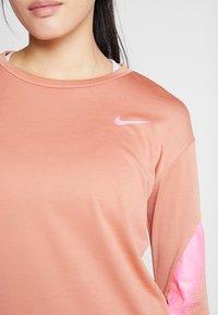 Nike Performance - MIDLAYER RUNWAY - Sports shirt - terra blush/digital pink - 5