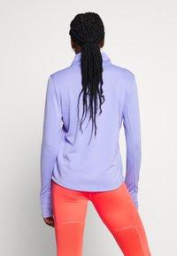 Nike Performance - MIDLAYER RUN - Sports shirt - light thistle - 2