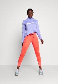 Nike Performance - MIDLAYER RUN - Sports shirt - light thistle - 1