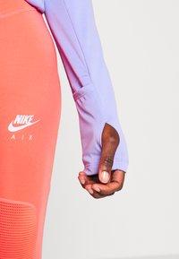 Nike Performance - MIDLAYER RUN - Sports shirt - light thistle - 5