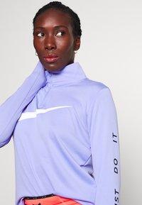 Nike Performance - MIDLAYER RUN - Sports shirt - light thistle - 3