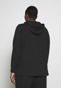 Nike Performance - YOGA COVERUP PLUS - Sports shirt - black - 2