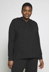 Nike Performance - YOGA COVERUP PLUS - Sports shirt - black - 0