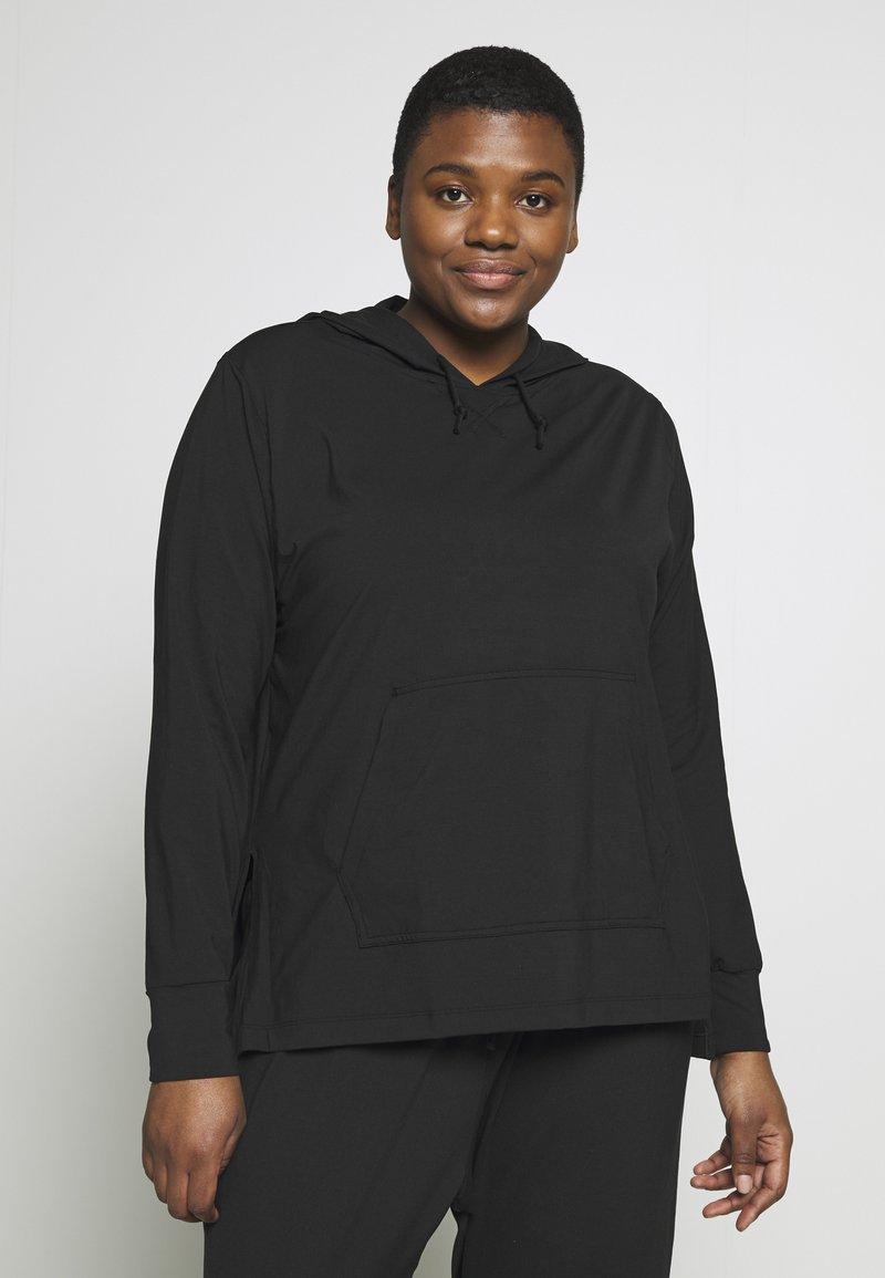 Nike Performance - YOGA COVERUP PLUS - Sports shirt - black