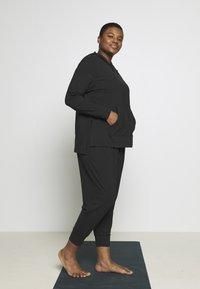 Nike Performance - YOGA COVERUP PLUS - Sports shirt - black - 1