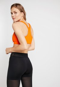 Nike Performance - CLASSIC - Sports bra - safety orange/orange quartz - 2
