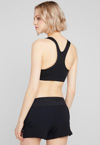 Nike Performance - CLASSIC - Sports bra - black/white