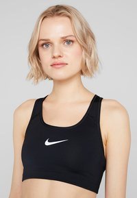 Nike Performance - CLASSIC - Sports bra - black/white - 4