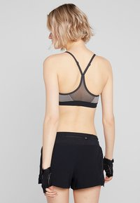 Nike Performance - INDY BRA - Sports bra - carbon heather/anthracite/black