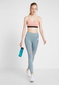 Nike Performance - INDY BRA - Sports bra - pink quartz/black - 1