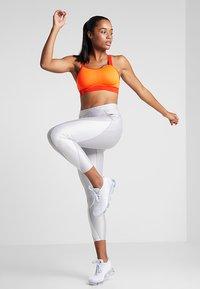 Nike Performance - BREATHE BRA - Sports bra - total orange/team orange/black - 1