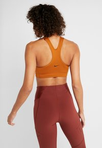 Nike Performance - Reggiseno sportivo - burnt sienna/black - 2