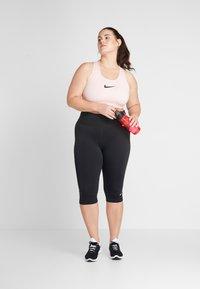 Nike Performance - Reggiseno sportivo - echo pink/black - 1