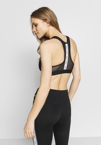 Nike Performance - BAND BRA NO PAD - Sport BH - black/white - 2
