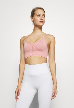 INDY SEAMLESS BRA - Sports bra - rust pink/white