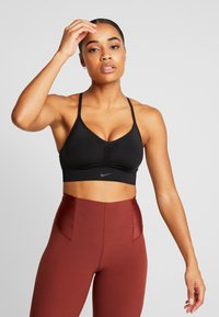 Nike Performance - INDY SEAMLESS - Sports bra - black/dark smoke grey - 0