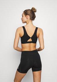 Nike Performance - FAVORITES NOVELTY BRA - Sports bra - black/smoke grey - 2