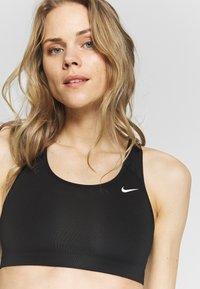 Nike Performance - BRA NON PAD - Sports bra - black - 4