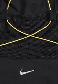 Nike Performance - BRA - Sport BH - black/earth/laser orange - 3