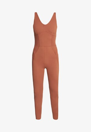 W NK YOGA LUXE JUMPSUIT - Tracksuit - red bark/terra blush